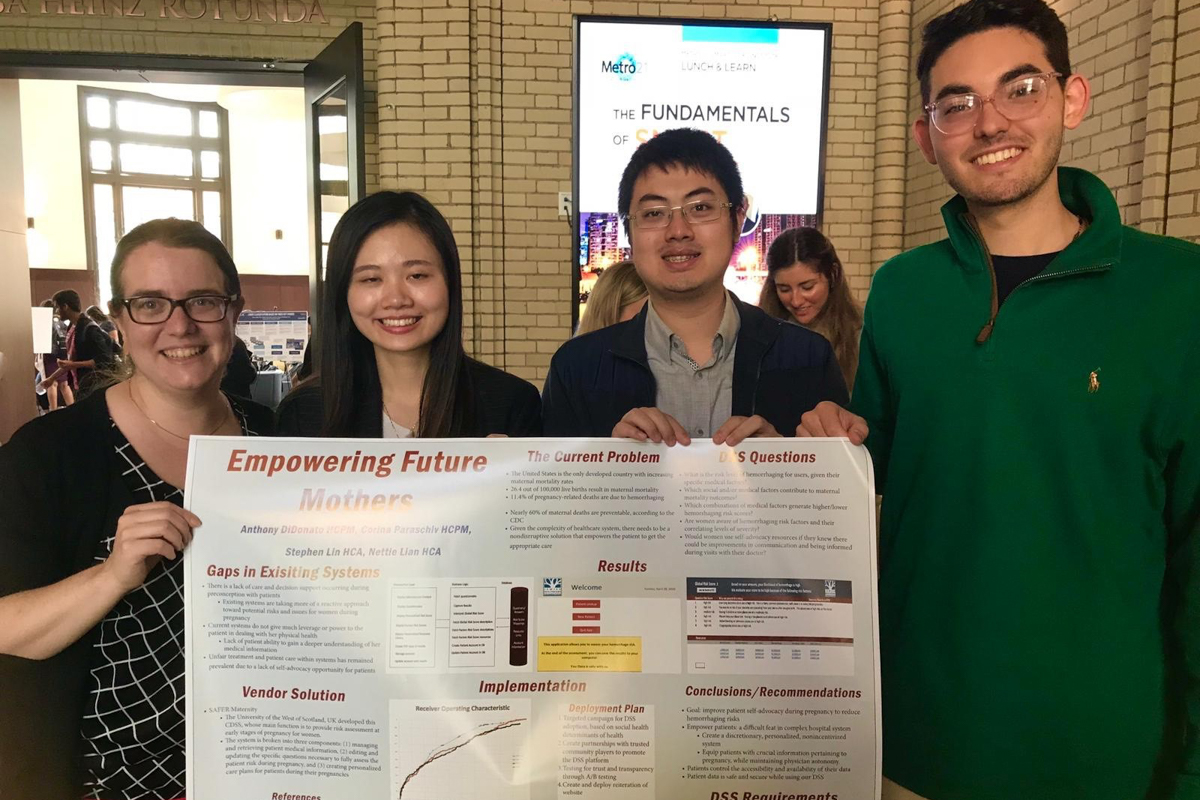Carnegie Mellon University students present their project, Machine Learning algorithm for Hemorrhage Risk Classification (from let to right): Corina Paraschiv, Jiaoying Lian, Dong-Lien Lin and Anthony Didonato.