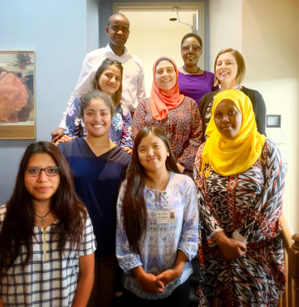The doulas took a break from training with (rear row, from left) Kheir Mugwaneza, Senior Project Manager for Allegheny Health Network's training program; WHAMglobal Global Health Associate Hanifa Nakiryowa; and Project Coordinator Katie Hyre.