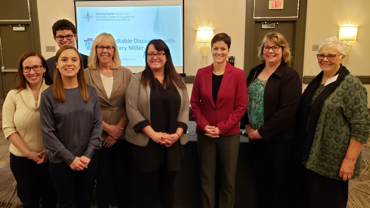 Secretary Teresa Miller (3rd to right) with members of JHF Staff and COE team administrators.