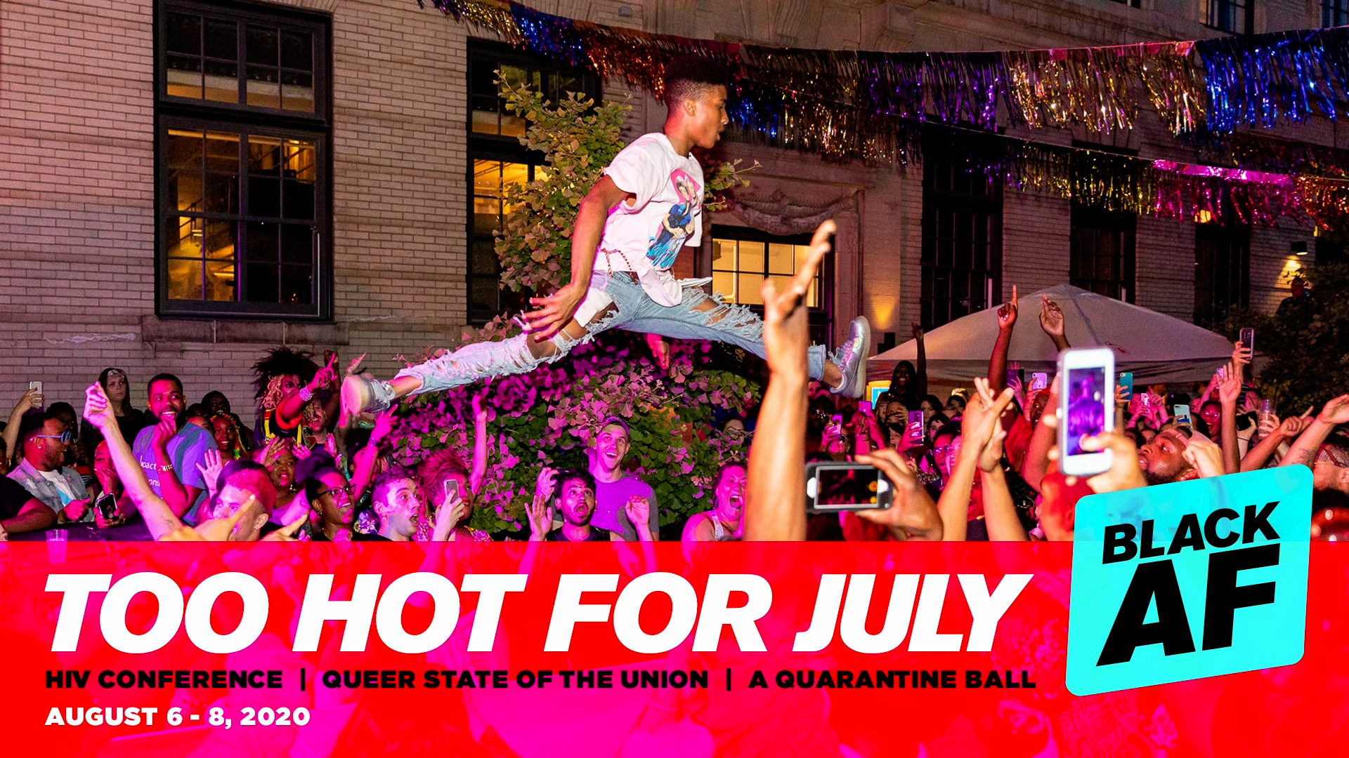 Participants of Too Hot for July in a previous year enjoy festivities and music. A crowd gathers raising phones in the air while a young man leaps over them.
